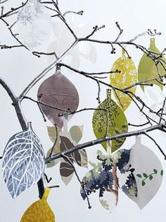 Decoration with paper leaves on a branch by Kim Timmerman