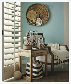 Target Home | The soft cloth bag and woven tray wall art provides rustic chic charm in this space.