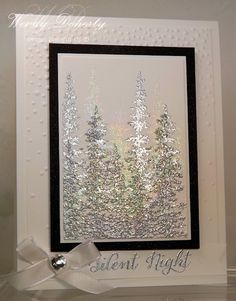 To create my frosty trees I stamped them twice with versa mark ink and then embossed with silver ep, then I stamped them again in versa mark ink and embossed with iridescent ice ep.  The black card stock was spritzed with frost white shimmer mist to soften the look.