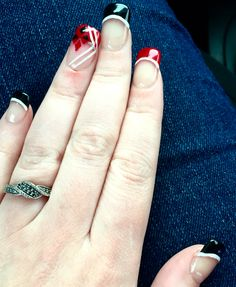 Harley Quinn inspired nails red and black diamond