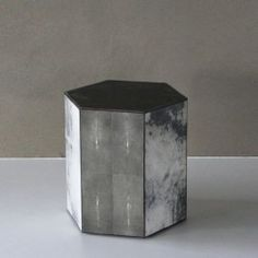 HONEYCOMB SMALL pillar hexagon, black stone top, dark grey parchment and tabac stingray. #Cravt #DKhome #Craftsmanship #Living #Pillars #Leather #Luxuryfurniture