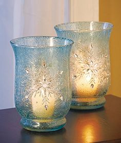 {WINTER HOME DECOR IDEAS} Frosted Glass:  A few pretty frosted glass jars or vases filled with other winter or holiday elements can make your holiday dinner table or mantle look beautiful.
