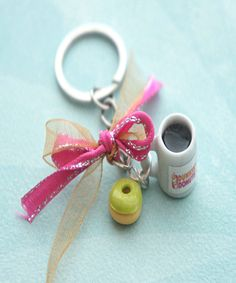 This key chain features a miniature Dunkin donut coffee cup charm along with a handmade donut charm sculpted from polymer clay. Both charms are attached to a silver tone keychain. SKU 11204