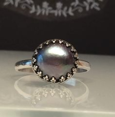 A personal favorite from my Etsy shop https://www.etsy.com/listing/510320718/grey-pearl-ringsolitare-pearl-ringpearl