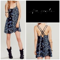 Free People Romper Floral print flowy romper with ties up the side. Crisscross back with adjustable straps.  Cover shot truest color  *100% Rayon  *Hand Wash Cold  *Black Combo Free People Dresses