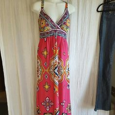 Spaghetti strap dress Light and a fun pattern on it. Not too low cut in the front! Its a great dress to go casual or dress up!  ***the size is a large but I'm a medium. The dress runs small! Im 36B chest 26/27 waist.. and it isnt too small or too big! Dresses Maxi
