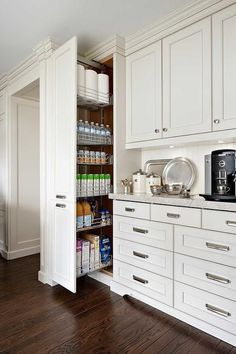 Fabulous kitchen features ivory raised panel cabinets paired with grey quartzite counters and a ...