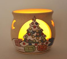Unique handmade ceramic tealight holder with carved Christmas tree detail. Fab!