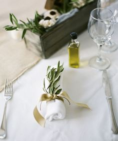 Grecian wedding table - Olive branch and a small bottle of keepsake olive oil for a Greek themed Wedding Favor Table, Wedding Table Decorations, Wedding Table Settings, Wedding Themes, Wedding Favors, Place Settings, Wedding Reception, Greek Wedding Theme, Wedding Gifts