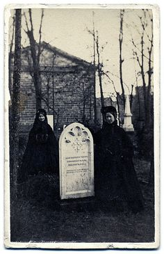 Two ladys in mourning at the grave of Mary Greenleaf Woods who died in  1864. Kenyon-Rosse Chapel Cemetery, Kenyon College, Gambier, Ohio.