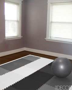Expert Home Gym Advice - Fitness Room Ideas - ELLE DECOR -- locking mat tiles with persian rug over the top