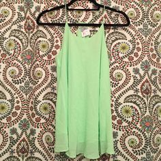 Apricot Lane Tank NWT Apricot Lane bright green tank. Double layered material, thin strap, racer back, perfect paired with a bralette or bandeau!! Apricot Lane Boutique Tops Tank Tops
