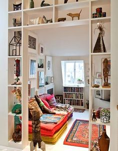 tear out a section of wall between din/liv or kit/fam and build shelves into the studs, paint. Makes it more open, and useful at the same time!