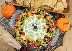 Scary good taco dip for your Halloween party! Spider Web Taco Dip By Sue Lau | Palatable Pastime I've seen pictures of this sort of thing all over the internet. I'd really like to say who inspired it, but there are so many now. Who knows from whence it came? But the inside is basically … Halloween Snacks, Halloween Fun, Halloween Dishes, Halloween Taco Dip, Halloween Food For Party, Halloween Themes, Holidays Halloween, Mexican Halloween, Halloween Recipe