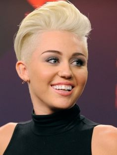 Miley Cyrus Undercut Hairstyle...not a fan of her, but damnitt I want to give this cut to someone