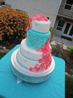 fuchsia pink flowers along turquoise and white cake fuschia wedding orange wedding wedding colors