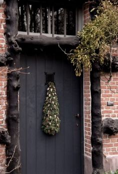"""This festively decorated front door is from our feature """"Spirits of Grace"""""""