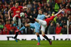 Jones and Blind defend Aguero. Manchester United v Manchester City