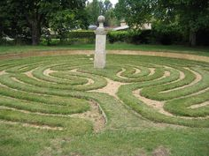 """There are 8 remaining ancient turf mazes in Britain. This is Hilton Maze in Cambridgeshire. The pillar at the centre reads """"William Sparrow, born 1641, died at the age of 88, formed these circuits in 1660"""". Hilton turf maze by boneychest, via Flickr"""