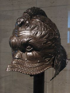 Helmet in the form of a Dolphin Mask-Giovanni Paolo Negroli Warrior Helmet, Helmet Armor, Arm Armor, Medieval Helmets, Medieval Armor, Medieval Fantasy, Collections D'objets, Ancient Armor, Fantasy Armor