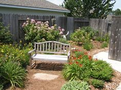 Cottage garden with bench.