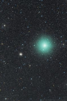Comet vs. Star Cluster Comet 252P/LINEAR and Star Cluster M14 At a distance of about 30,000 light-years, M14 contains several hundred thousand stars. Comet 252P/LINEAR is a periodic comet and near-Earth object discovered by the LINEAR survey on April 7, 2000. The comet is an Earth-Jupiter family comet, meaning that it passes quite close to both Earth and Jupiter.