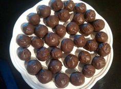 ~ Pecan Pie Balls Recipe ~ 2 1/2 c pecans, toasted and chopped ~ 1 c graham crackers, crushed ~ 1 c  brown sugar ~ 1/2 tsp salt ~ 2 Tbsp maple syrup ~ 1/4 c bourbon, brandy or spiced rum ~ 1 tsp vanilla ~ 7 oz dark chocolate bark ~ 1 tsp coarse sea salt (optional) ~