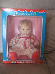 This was the Baby Ann doll from Fisher Price.Ann was my constant companion for a long time.i remember a doll with an outfit like this but i thought it had dark hair but for some reason i called it baby ann