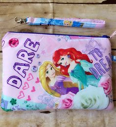 Disney wristlet purse, zippered wristlet pouch, Disney Princesses by PopThree on Etsy https://www.etsy.com/listing/469686001/disney-wristlet-purse-zippered-wristlet