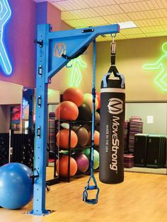 MoveStrong Heavy Bag Stand and Functional Fitness Column. Gym design and equipment to accommodate boxing and kickboxing bags along with suspension training, resistance bands, battle ropes, and more. Floor anchored, commercial heavy duty, and made in USA.