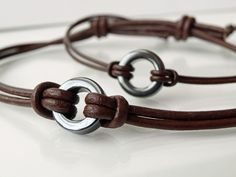 His & Hers Eternity bracelets-Hematite & Leather Eternity Bracelet, Bracelet Set, Mens Leather Accessories, Fashion Accessories, Men's Leather, Brown Leather, Fabric Gift Bags, Sliding Knot, Circle Of Life