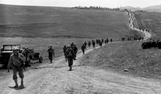 US infantry advancing, somewhere in Tunisia.
