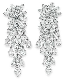 A PAIR OF DIAMOND EAR PENDANTS, BY DAVID WEBB  Each designed as an articulated variously-shaped diamond tapered cluster, mounted in platinum