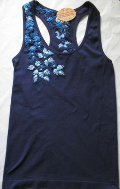 hand embroidered, front and back, navy blue, with beads and sequins