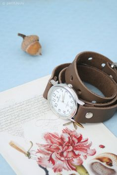 brown leather bracelet wrap around wrist with silver watch face