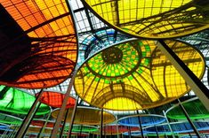 "Daniel Buren : ""The breakthrough came when I finally realized that this iron and glass architecture (the Grand Palais - Paris) was based on the circle and that the main tool used to design the building was a compass"". The artist also declares : ""One of the things I want to show and take into account as an essential part of this place is its volume, the air circulating, its light. This is a great place to sculpt the air and give it a shape, capture light and give it a color."""