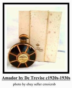 Amador by De Trevise: launched in the black glass bottle, disk shaped, gilded radiating lines, demilune stopper made of gilded black glass. Glass Bottles, Perfume Bottles, Black Perfume, Vanity Design, Vintage Bottles, Needful Things, Black Glass, Vintage Black, Container