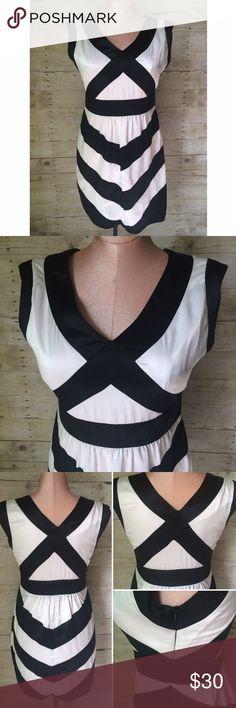 Bisou Bisou black & white dress. Bisou Bisou black & white satin banded dress with v-neck and side zipper. Lined. Size is 12. 100% polyester. Not interested in trades. Bisou Bisou Dresses