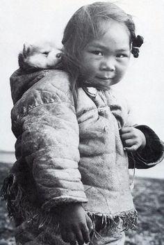 Little Inuit girl and her husky