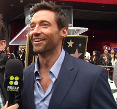 Hugh Jackman is all smiles at his Walk of Fame Star ceremony. #LesMis
