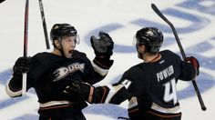 Anaheim Ducks center Nick Bonino, left, celebrates his game winning goal with Cam Fowler, against the Detroit Red Wings during overtime in Game 5 of their first-round NHL hockey Stanley Cup playoff series in Anaheim, Calif., Wednesday, May 8, 2013.