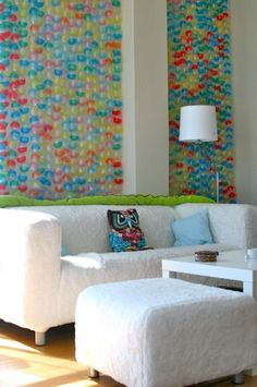 Wall art made from plastic coin machine toy containers