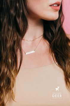 Personalized jewelry just for you. Our initial bar necklace is shiny and sleek, wear it solo layered. Available in gold fill or sterling silver. #goldjewelry #daintyjewelry