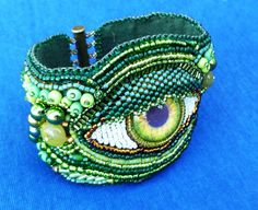 green 'eye' hand beaded embroidered cuff. $99.00, via Etsy.