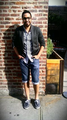 Kenan, the ultimate Brooklyn hipster. Sporting head to toe Uniqlo, including a checkered button-up, cotton blazer, DIY cut-offs, and obvs boat shoes. Photo taken outside Brooklyn Bowl.
