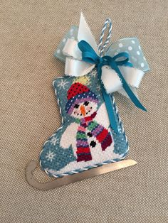 Snowman ice skate ornament ~ Canvas by Shelly
