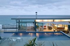 Glass & Steel Beach House near Tatapouri Point in New Zealand.