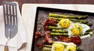If you're worried about breaking the egg yolks, crack each egg, one at a time, into a small cup or bowl before pouring onto the asparagus.