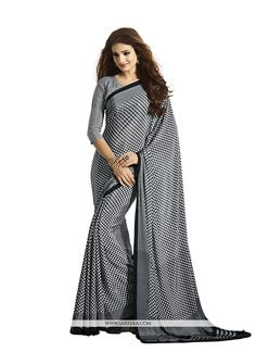 Fashion and style always depends on good color and fantastic combination of shades and so we create best shades to enhance your beauty and personality. Be your own style diva with this grey faux crepe...