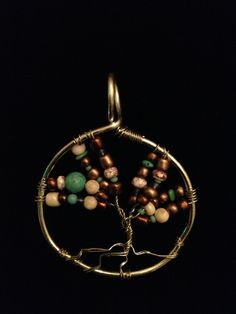 Silver and mixture of neutral colored, green,  and blue stones and beads.